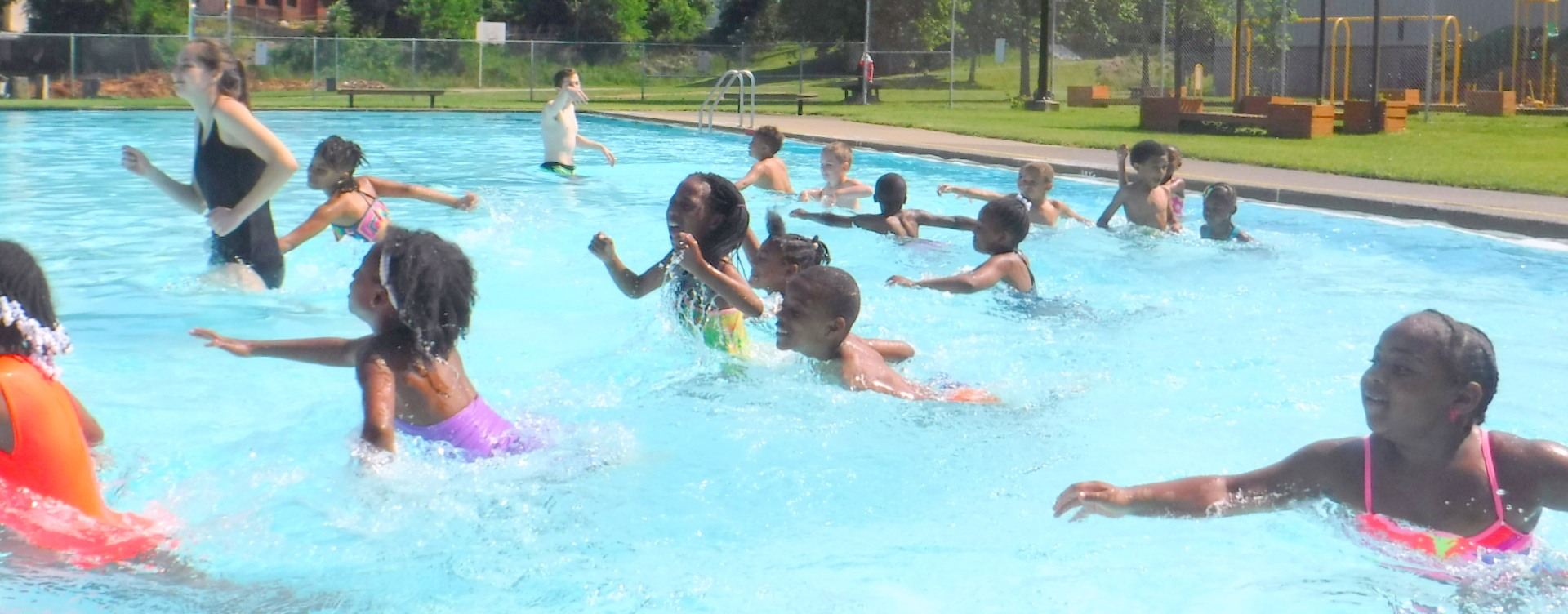 Kids running in the swim pool at The Pittsburgh Project